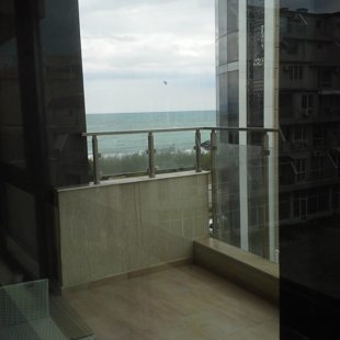 On the right, one can see the facade of the newly built apartment building..