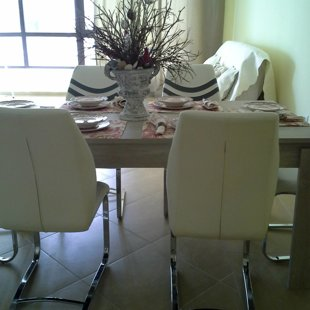 The eco-leather dining chairs are ergonomic and easy to maintain.