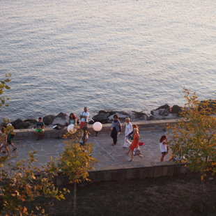 The sea promenade is a popular place for sunbathing on the stone benches or  strolling