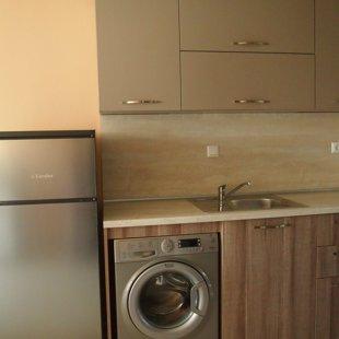 Refrigerator with a top freezer.