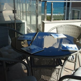 The terrace is sunny in the morning and pleasantly breezy later in the day.